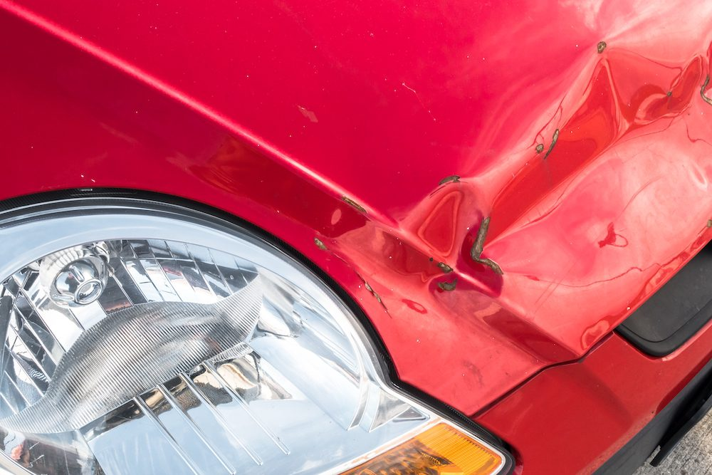 Red Car Damaged